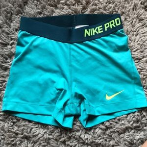 Nike pro spandex, teal and neon yellow